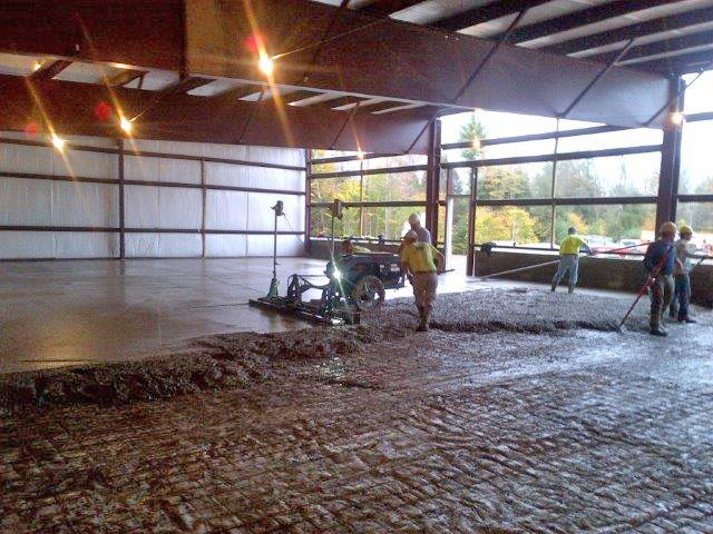 Work continues to pour the concrete floor