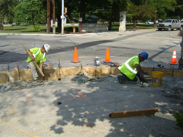 Concrete work for ADA ramps at the corner of Ridgeway and Prospect streets in East Stroudsburg, across from the entrance to East Stroudsburg University.