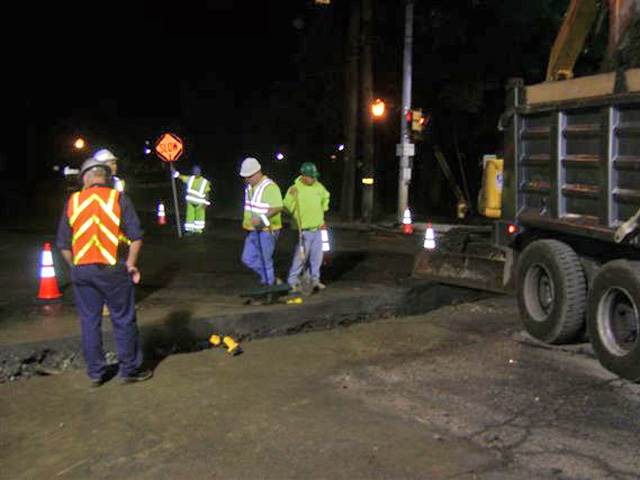Sanitary sewer line replacement work taking place at night, to lessen the impact on traffic.