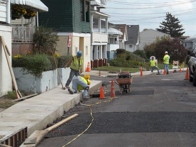 Working on new sidewalks, East Grove Street, Edwardsville, Pa.